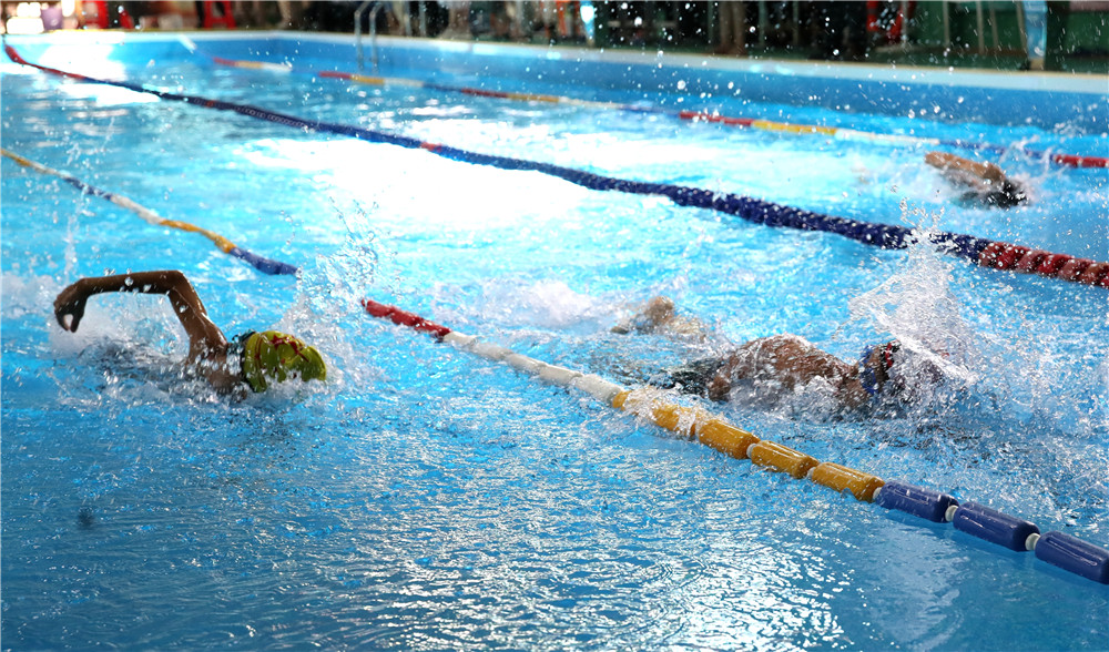 2019年海口市第一届中小学生游泳比赛火热开赛  游泳普及成果显著