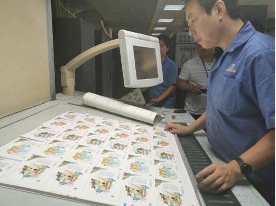 郑州日报:第十一届全国少数民族传统体育运动会邮资明信片开机印制
